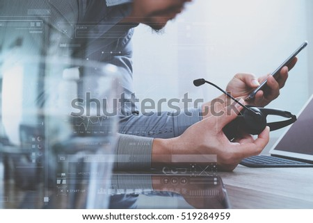 Man using VOIP headset with digital tablet computer docking smart keyboard, concept communication, it support, call center,screen graphic virtual icons,graph,diagram