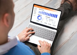 Man viewing website traffic analytics data on laptop computer