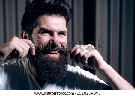 Man visiting hairstylist in barber shop. He is doing styling with the shaver. Barber Shop Studios. Beard styling cut. Trims. Bearded man. Barber scissors and straight razor barber shop