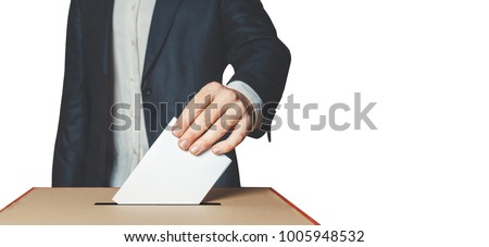 Man Voter Putting Ballot Into Voting box. Democracy Freedom Concept Isolated With Copy-Space - Shutterstock ID 1005948532