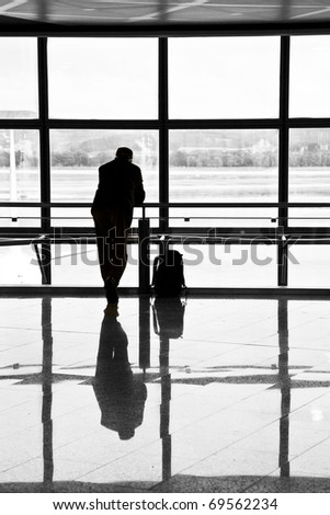 man waiting for departure of flight at the airport