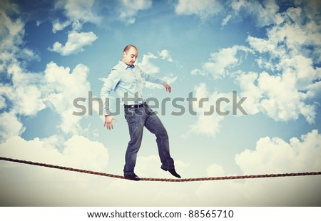 man walk on rope with blue sky background