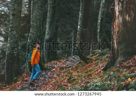 Man walking alone in deep forest Travel healthy active lifestyle adventure vacations outdoor exploring wilderness #1273267945