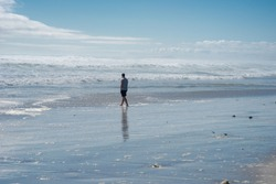 Man walking alone on the beach