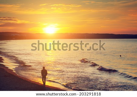 man walking alone on the beach...