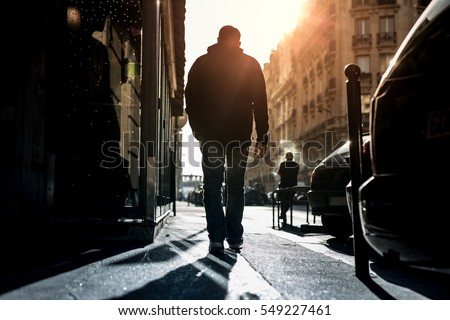 man walking alone through the...