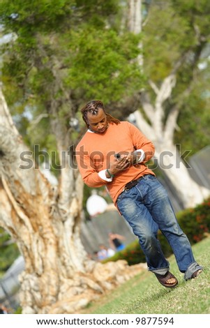 Man Walking and Dialing the Phone - stock photo