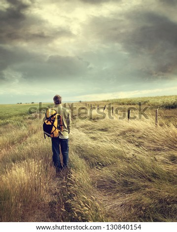 Man walking down country road on the prairies