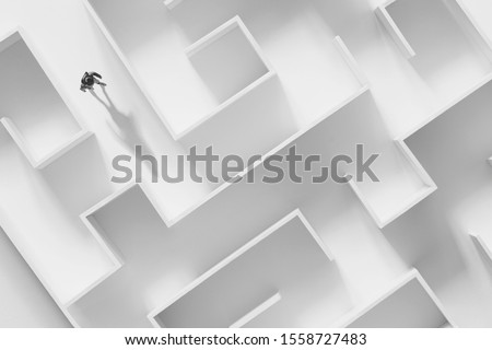 man walking in a complex white maze, surreal concept