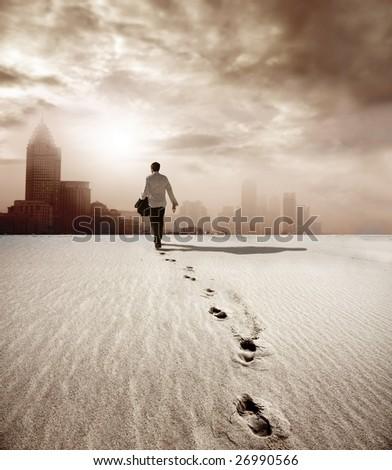 man walking in a desert towards a city