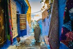 man walking in Chefchaouen street, Morocco