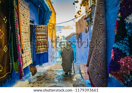 man walking in Chefchaouen street, Morocco   #1179393661