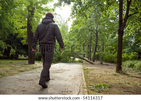 Man walking in damaged park