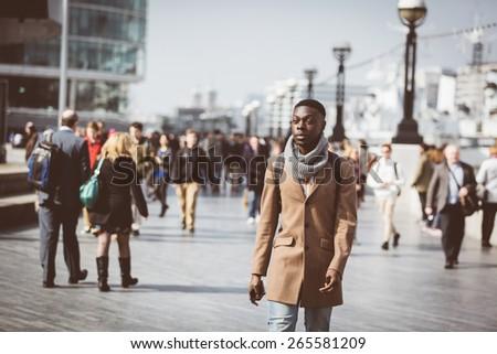 man walking in london on thames ...