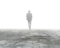 Man walking in mystery fog on dirty concrete floor