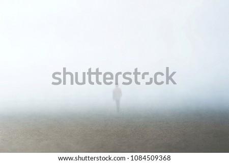 man walking in the fog