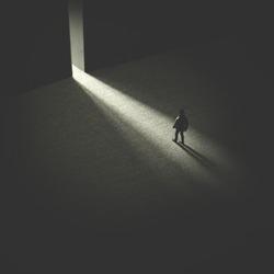 man walking in the night following light, open door concept