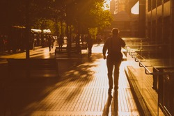Man walking in the street on a sunny afternoon