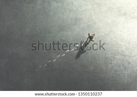 Photo of  man walking in the streets leaving footsteps on the ground, past concept