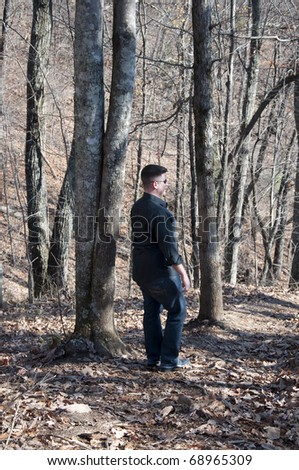 Man Walking in the Woods Seen from Behind.