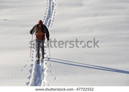 Man walking on ski in the snow