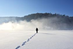 Man walking on snow, footprints in snow, behind
