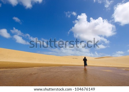 Man walking on the Giant Dune looks like a desert. Far North New Zealand.