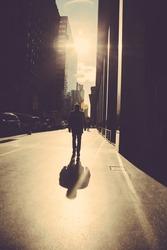 Man walking on the street of New York  at sunrise