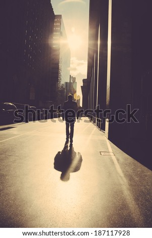 Man walking on the street of New York  at sunrise