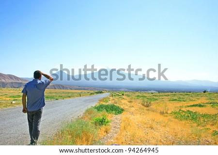 Man walking to Ararat mountain in Armenia.