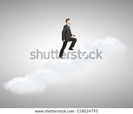 man walking  up stairs out of clouds