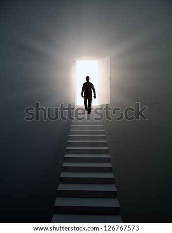 Man walking up the stairs to open doors