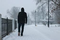 man walking winter. snow blizzard. snow around