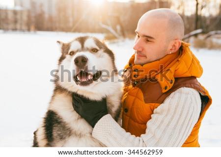 Man walking with dog winter