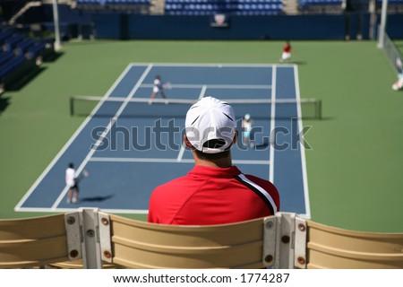 Man watching a tennis match