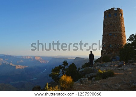 Man watching Sunrise from Deser View Point, Grand Canyon, AZ