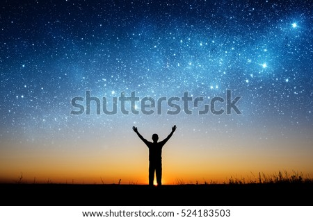 Man watching the stars. Elements of this image furnished by NASA. #524183503