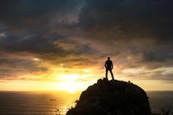 Man watching the sunset over the sea, Mount Jaizkibel, Euskadi