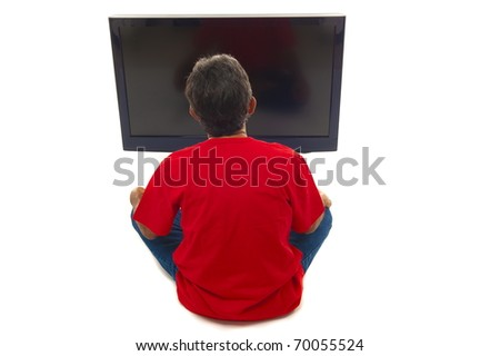 Man watching tv with hands on the head .