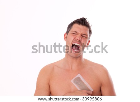 Man waxing his breast to depilate hair