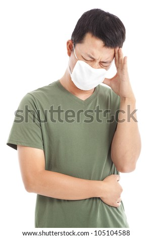 man wearing a face mask with headache