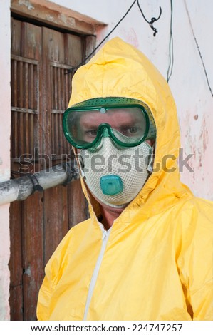 Man wearing a hazmat suit in the face of infectious disease
