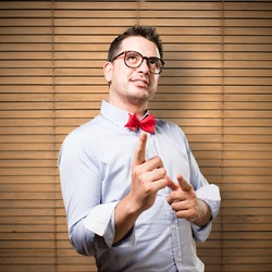 Man wearing a red bow tie. Looking confident.