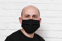 Man wearing black cotton protective mask