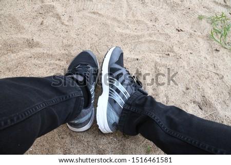 Man wearing black shoes Wearing shoes