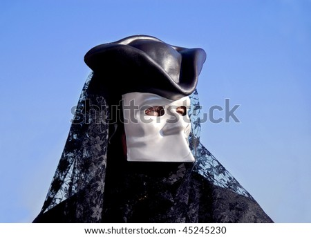 Man wearing black traditional venetian carnival mask