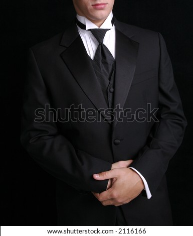 Man wearing black tuxedo, dress for special occassion.
