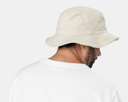 Man wearing bleached bucket hat, rear view