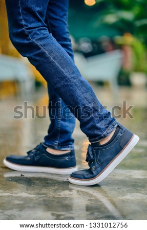 Man wearing Blue suede leather shoes - semi formal - casual wear - sneakers with ground reflection - product shots #1331012756
