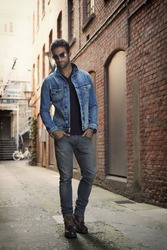 Man wearing denim jacket and jeans in street